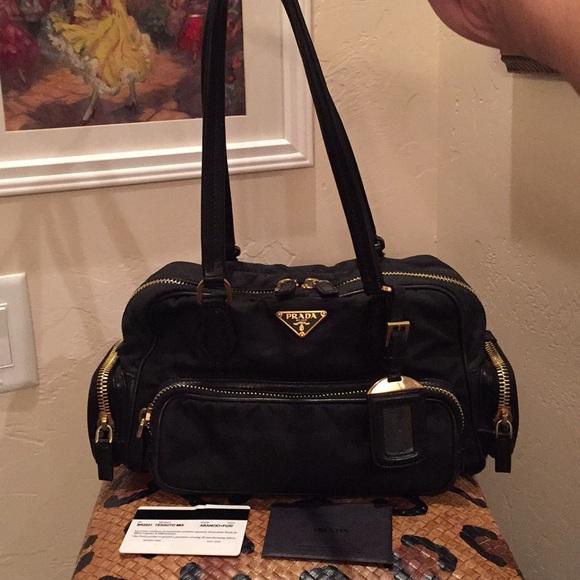 e715c30d7f5884 Prada Canapa Leather And Nylon Handbag. M_5b971c50fe5151408d2d9a69